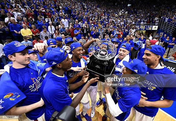 The Kansas Jayhawks celebrate a 12th consecutive Big 12 Conference title with a 6758 win against Texas Tech on Saturday Feb 27 at Allen Fieldhouse in...