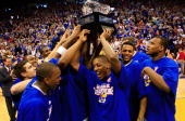 The Kansas Jayhawks celebrate with the Big XII conference trophy after defeating the Texas Longhorns on March 3 2007 at Allen Fieldhouse in Lawrence...