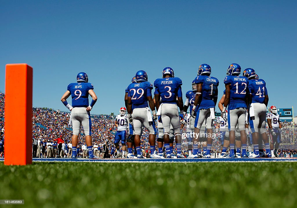 The Kansas Jayhawks offense waits during a timeout in the game against the Louisiana Tech Bulldogs at Memorial Stadium on September 21, 2013 in Lawrence, Kansas.