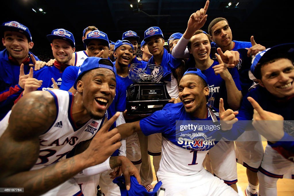 The Kansas Jayhawks pose with the trophy after defeating the West Virginia Mountaineers to win the game and clinch an eleventhstraight Big IX...