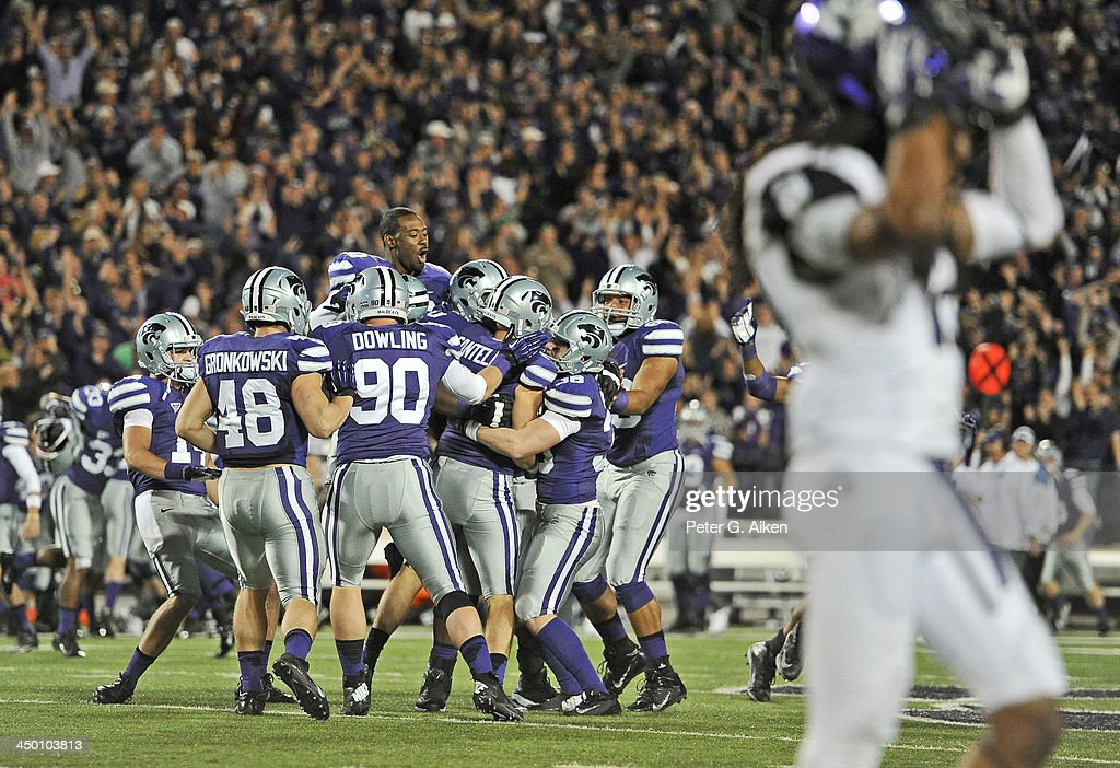 The Kansas State Wildcats celebrate after kicker Jack Cantele kicked a 41-yard field goal to beat the TCU Horned Frogs on November 16, 2013 at Bill Snyder Family Stadium in Manhattan, Kansas. Kansas State defeated TCU 33-31.