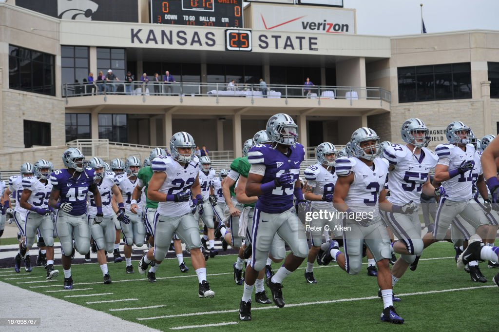 The Kansas State Wildcats run onto the field before the Purple and White Spring Game on April 27, 2013 at Bill Snyder Family Stadium in Manhattan, Kansas.