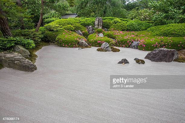 The karesansui zen garden of raked sand rocks and plants at Meigetsuin Temple Garden represents legendary Mount Shumi or Sumeru an imaginary mountain...