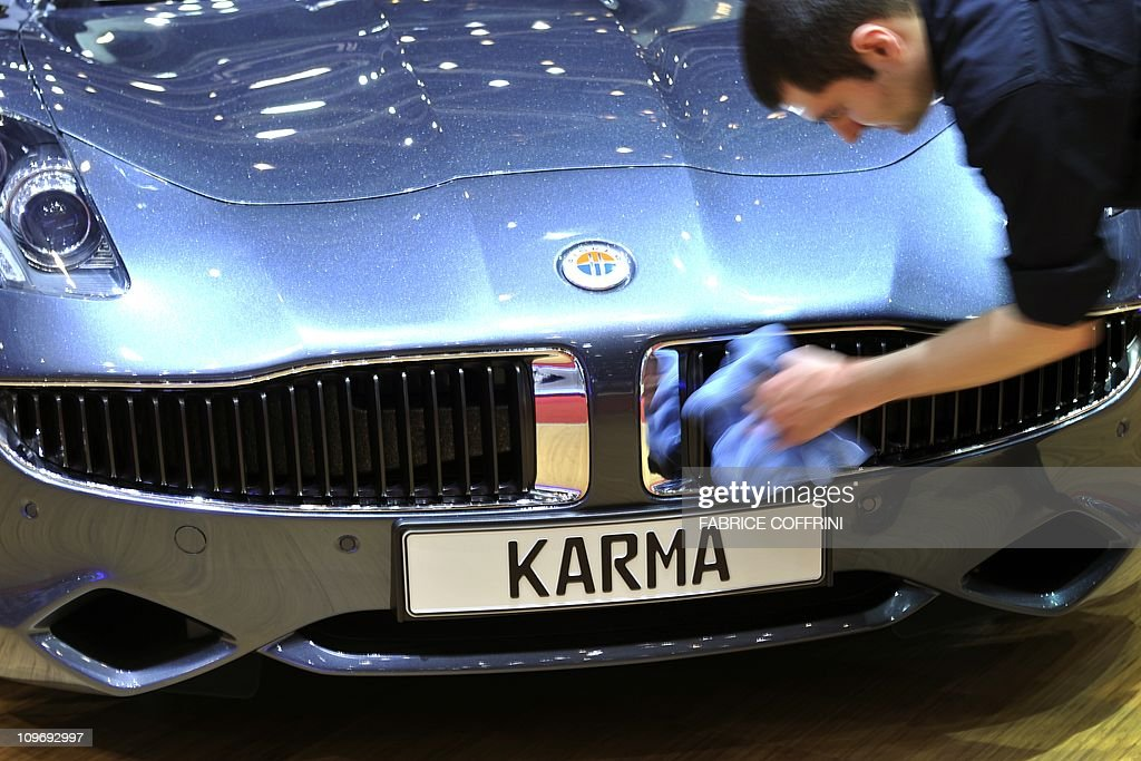 The Karma concept car is diplayed at Fisker Automotive carmaker's booth on March 1, 2011 during the Geneva Motor Show in Geneva. The show in the wealthy Swiss city attracts an expected 700,000 paying visitors and 260 exhibitors from 31 countries.