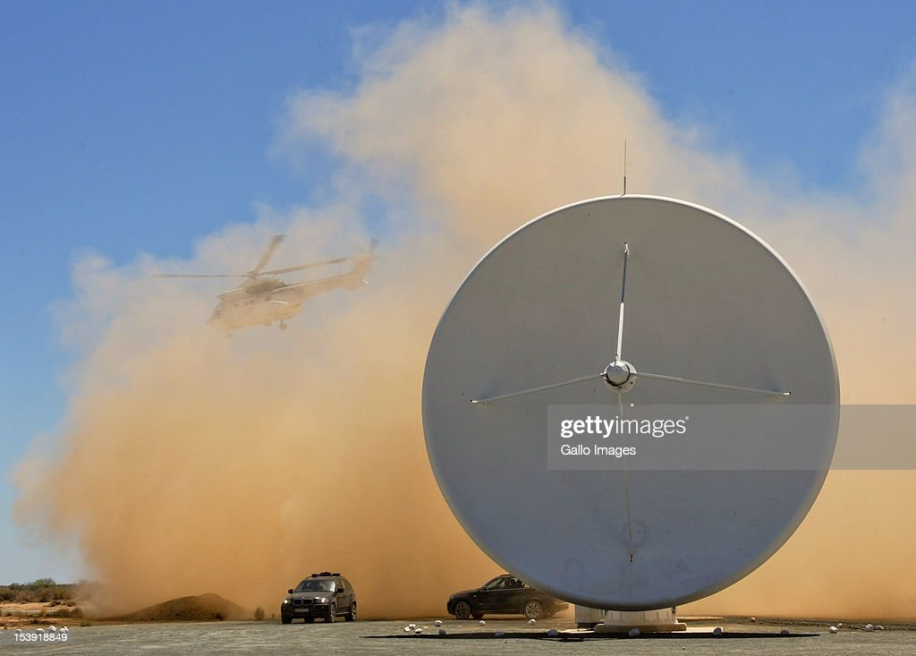 The KAT-7 telescope is engulfed in smoke as the helicopter carrying President Jacob Zuma lands the SKA (Square Kilometre Array) project site on October 9, 2012 in Carnavon, South Africa. President Zuma called the project an opportunity to recruit young people to pursue careers in science and technology. The SKA - or Square Kilometre Array, already includes seven telescope dishes and will feature many more from 2013 onwards.