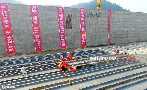 The keel of Titanic's replica is laid by working staff in a project on November 30 2016 in Suining Sichuan Province of China The Sinking of Titanic...