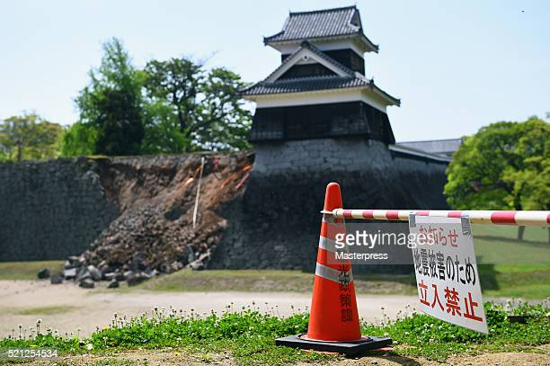 The 'keep out' sign and the damaged stone wall of Kumamoto Castle are seen on April 15 2016 in Kumamoto Japan Kumamoto Castle is a major tourism...
