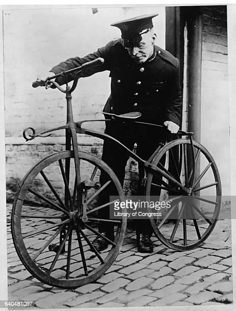 The keeper at the Coventry Municipal Museum with the first pedal bicycle with solid iron saddle and tires which laid the foundations of Coventry's...