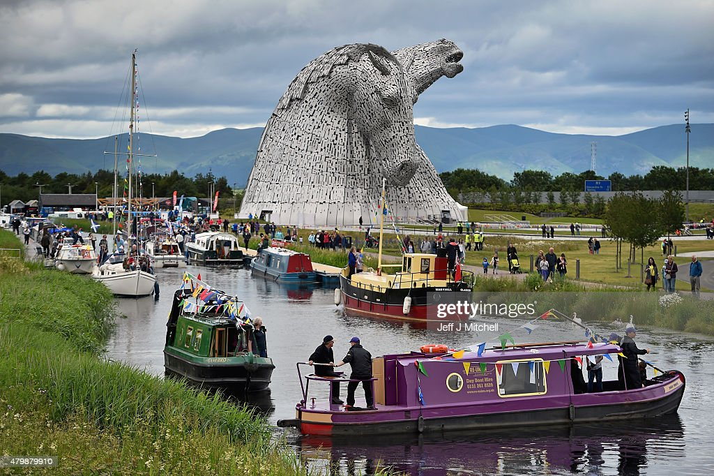 The Kelpies sculptures are officially opened by Princess Anne, Princess Royal and a flotilla of boats on July 8, 2015 in Falkirk, Scotland. Sculptor Andy Scott also attended the opening, along with Duke, a Clydesdale horse which was one of the models for the 30m works, which have received more than one million visitors since they were completed in April 2014.