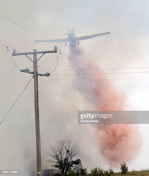 The Kennedy Air Ag plane saving houses yesterday GUNNEDAH FIRE BOMBING BY KENNEDY AIR HELPED SAVE MANY HOUSES FROM BEING DESTROYED PHOTOS PAUL MATHEWS