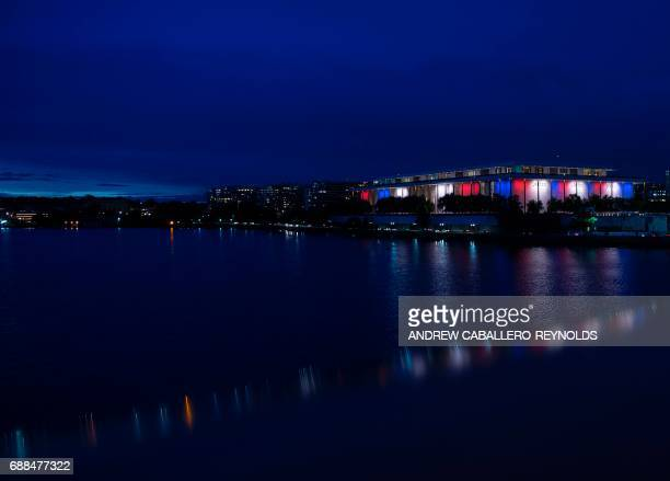 The Kennedy Center is illuminated in red white and blue with the words 'JKF 100' in honor of the birth centennial celebrations of 35th US president...