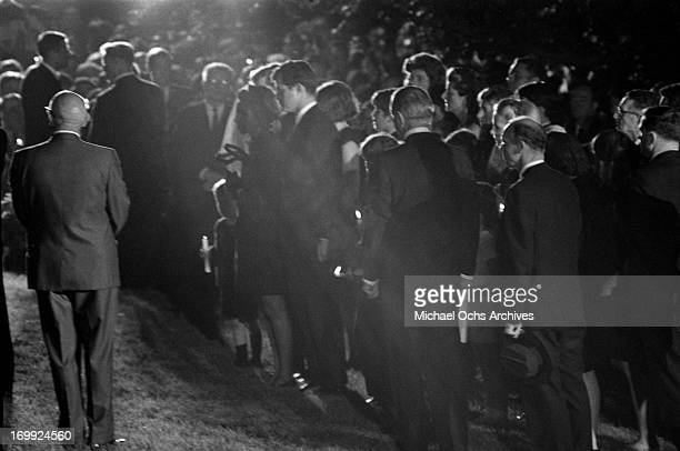 The Kennedy family gather at the grave site at Arlington National Cemetery for the funeral of Senator Robert Kennedy on June 9 1968 in Arlington...
