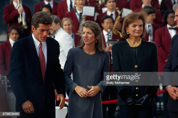 The Kennedys attend an event at the Kennedy Library with a band playing behind them They are there to meet President Clinton who is visiting Boston