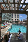 The Kensington luxury apartments at 665 Washington St offers many amenities such as a rooftop pool outdoor lounge area game room and workout/fitness...