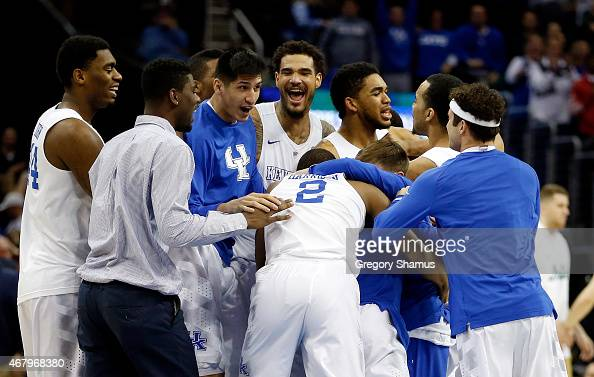 The Kentucky Wildcats celebrate after defeating the Notre Dame Fighting Irish during the Midwest Regional Final of the 2015 NCAA Men's Basketball...
