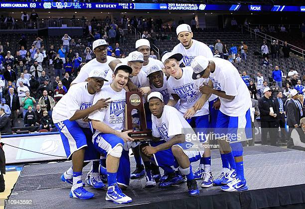 The Kentucky Wildcats celebrate with the trophy after defeating the North Carolina Tar Heels in the east regional final of the 2011 NCAA men's...