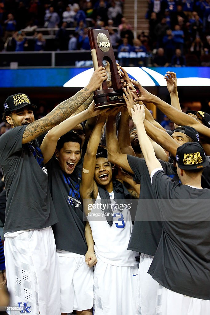 The Kentucky Wildcats hold up their trophy after defeating the Notre Dame Fighting Irish during the Midwest Regional Final of the 2015 NCAA Men's...