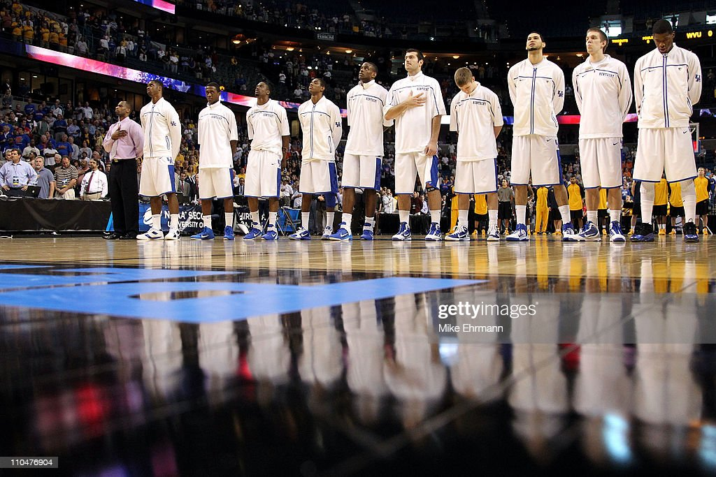 The Kentucky Wildcats line up for the performance of the National Anthem prior to playing against the West Virginia Mountaineers during the third...