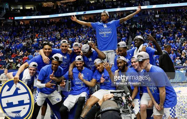 The Kentucky Wildcats pose for photos after an 8265 victory over Arkansas to win the SEC Tournament Champion Game at Bridgestone Arena on March 12...