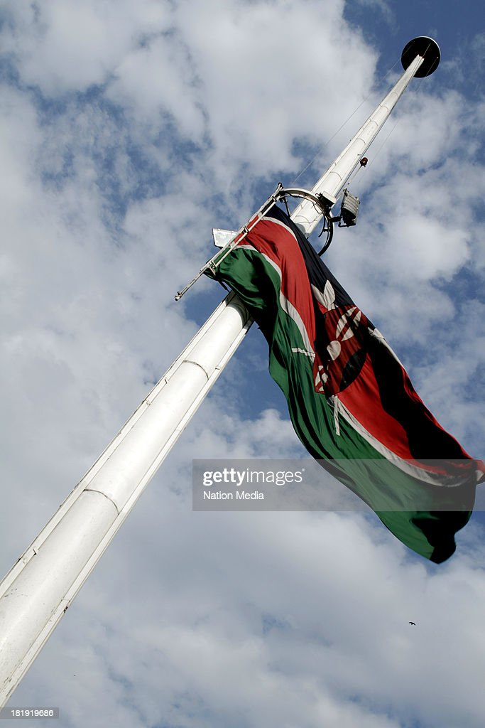 The Kenyan Flag flies at half mast to honour the victims of the Westgate Mall attack on September 25 2013 in Nairobi Kenya The Mall was hit with a...