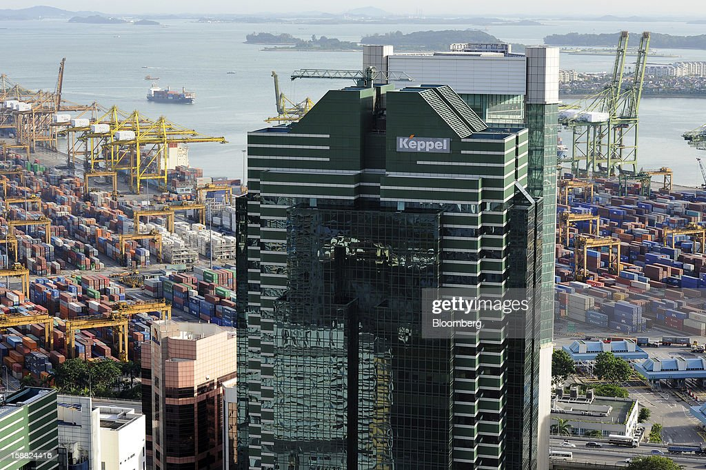 The Keppel Corp. logo is displayed atop Keppel Towers near the port in Singapore, on Friday, Dec. 28, 2012. Singapore may grapple with elevated inflationary pressures for a third year in 2013, reducing scope for the central bank to provide stimulus to an economy that probably entered a technical recession this quarter. Photographer: Munshi Ahmed/Bloomberg via Getty Images