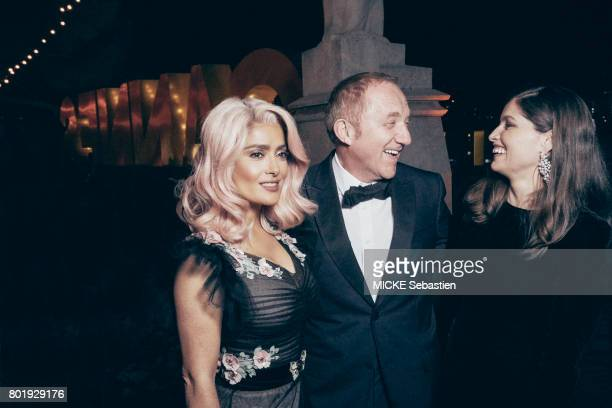 the Kering Woman in motion evening organised by Kering in Cannes Laeticia Casta Salma Hayek and FrancoisHenri Pinault May 21 2017 Laeticia Casta...