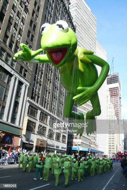 The Kermit the Frog balloon floats down the street at the 76th Annual Macy's Thanksgiving Day Parade in Herald Square November 28 2002 in New York...