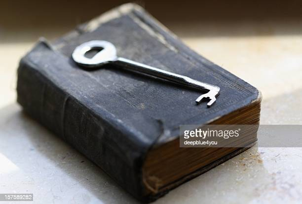 The key lying on old book / bible
