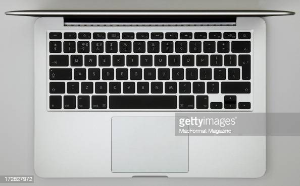 The keyboard and trackpad of an Apple 13' MacBook Pro laptop with Retina display photographed during a studio shoot for MacFormat Magazine November...