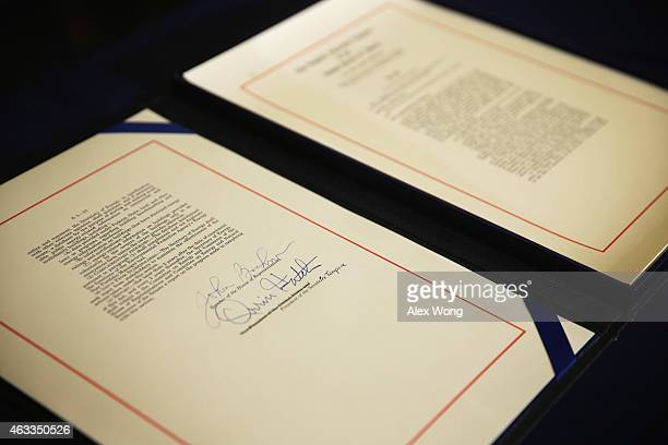 The Keystone XL Pipeline Approval Act is seen with the signature of Speaker of the House Rep John Boehner and Sen Orrin Hatch after a signing...