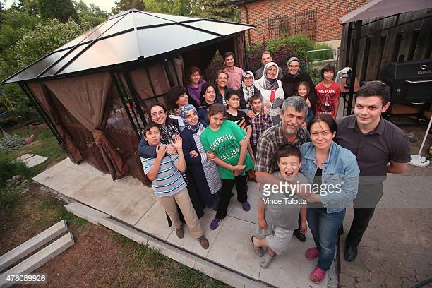 The Khalilov family Eskender father Alie mother and sons Enver 10 years old and Khalil gather with friends just before their Ramadan dinner in their...