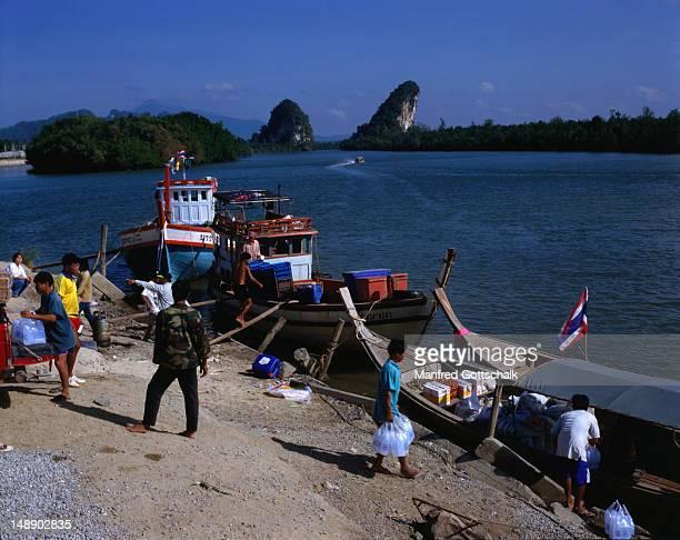 The Khao Khanaab Nam limestone cliffs form an impressive gate before the Krabi River reaches the City of Krabi