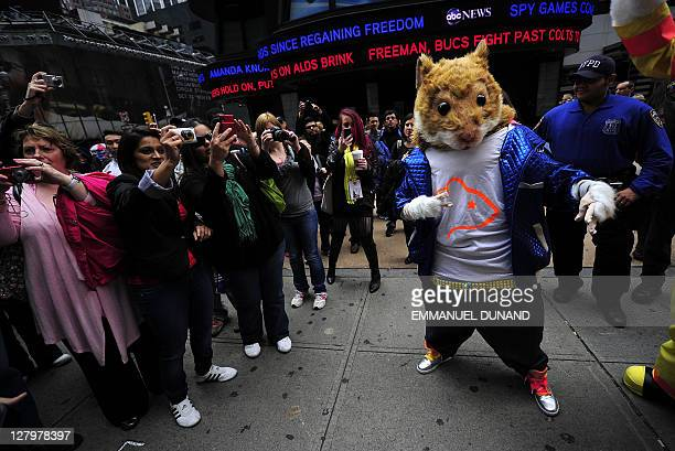 The KIA car hamster with onlookers as it partcipates in celebrations of The Michelin Man's entry into the New York Advertising Week's Walk of Fame as...