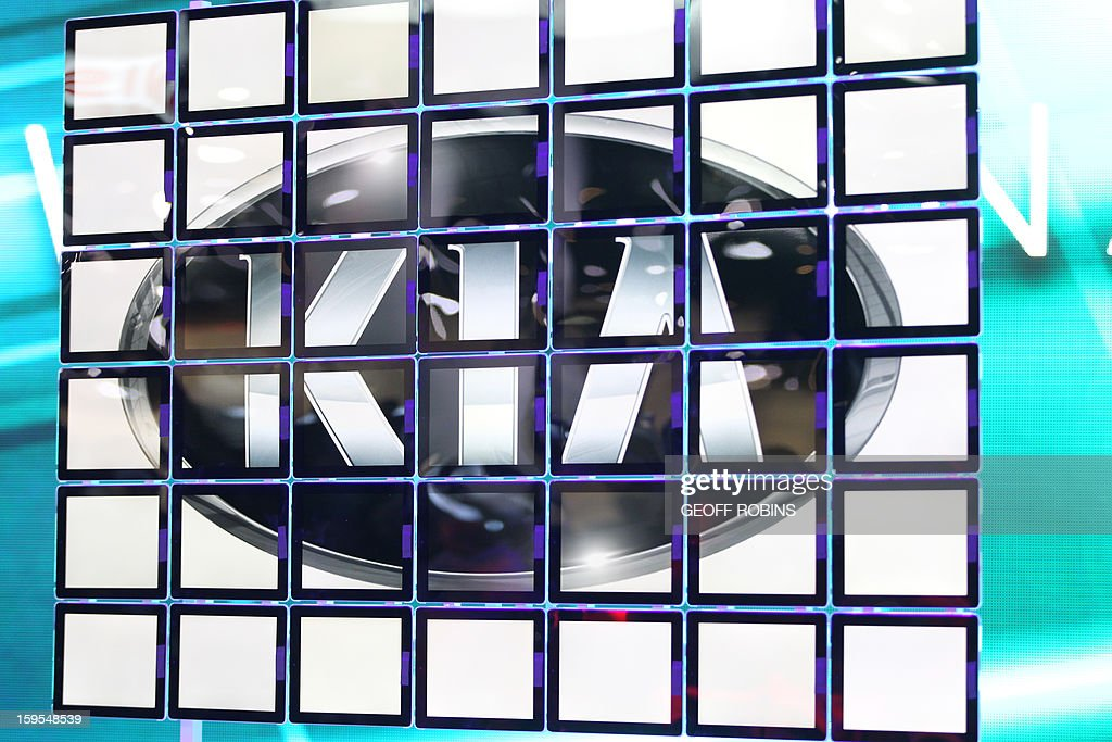 The Kia logo is seen at the 2013 North American International Auto Show in Detroit, Michigan, on January 15, 2013. AFP PHOTO/Geoff Robins