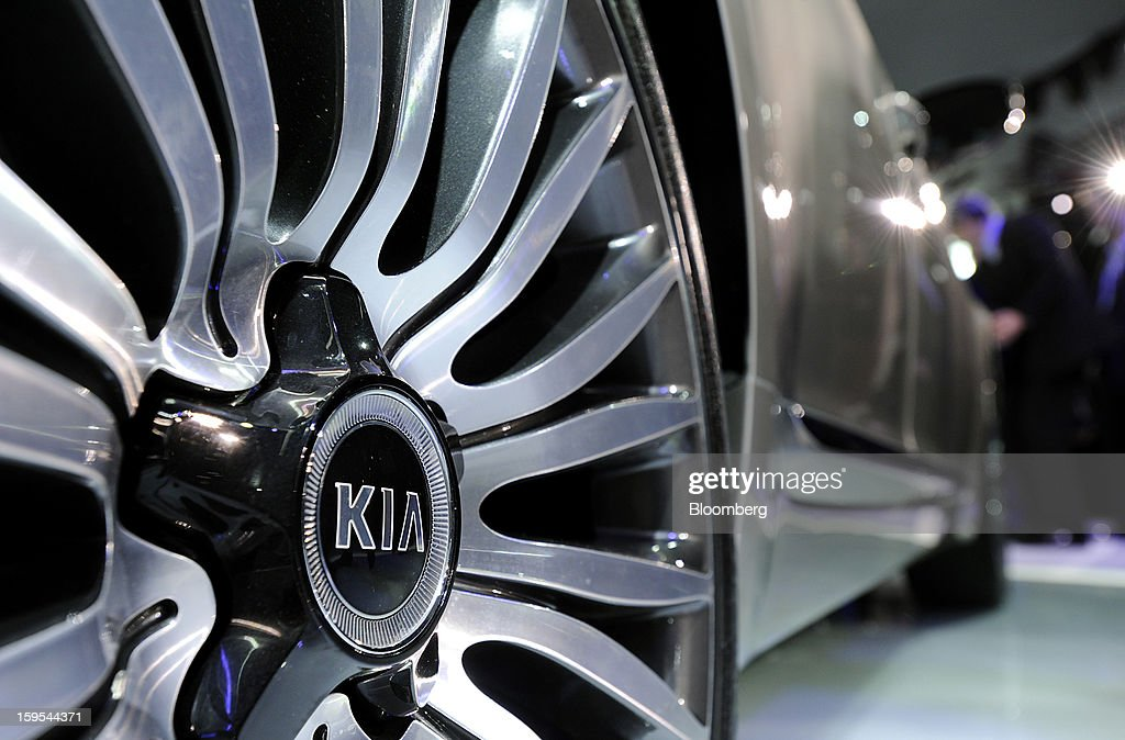 The Kia Motors Corp. logo is seen on a hubcap of the Cadenza sedan after it is unveiled during the 2013 North American International Auto Show (NAIAS) in Detroit, Michigan, U.S., on Tuesday, Jan. 15, 2013. The Detroit auto show runs through Jan. 27 and will display over 500 vehicles, representing the most innovative designs in the world. Photographer: David Paul Morris/Bloomberg via Getty Images