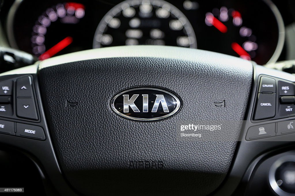 The Kia Motors Corp. logo is seen on the steering wheel of a vehicle displayed during the LA Auto Show in Los Angeles, California, U.S., on Thursday, Nov. 21, 2013. The 2013 LA Auto Show is open to the public Nov. 22 - Dec. 1. Photographer: Jonathan Alcorn/Bloomberg via Getty Images
