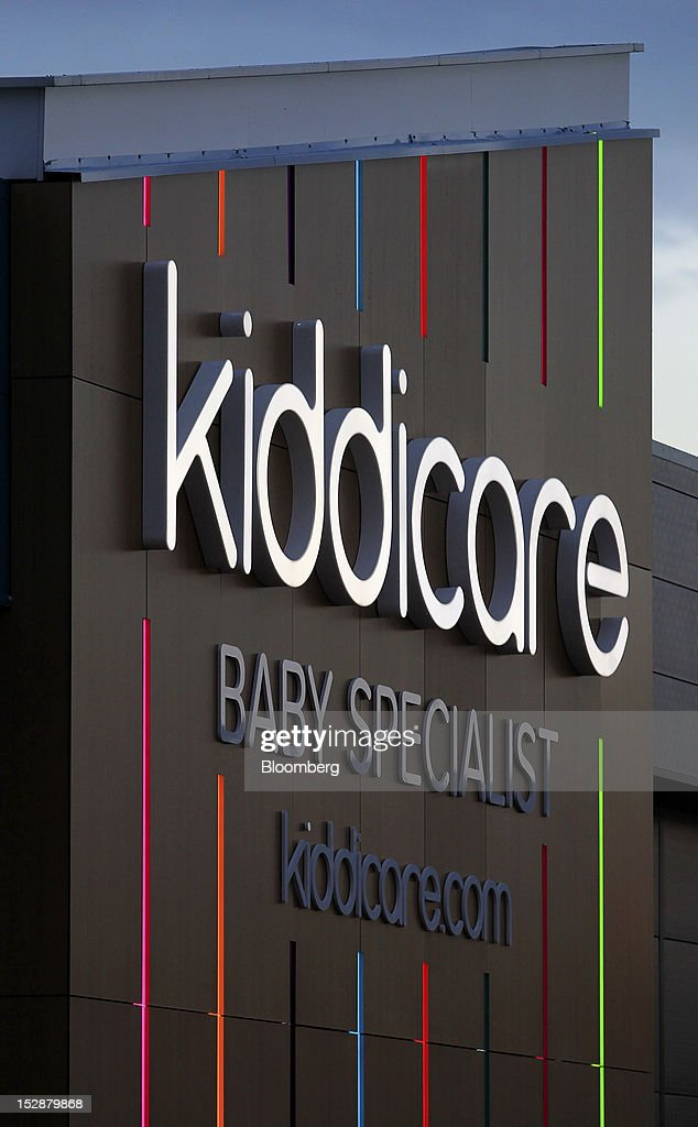 The Kiddicare Ltd. logo, a unit of WM Morrison Supermarkets Plc, is displayed outside the company's store in Nottingham, U.K., on Wednesday, Sept. 26, 2012. An index of U.K. retail sales rose for the first time in three months in September and stores expect demand to increase further next month, the Confederation of British Industry said. Photographer: Paul Thomas/Bloomberg via Getty Images