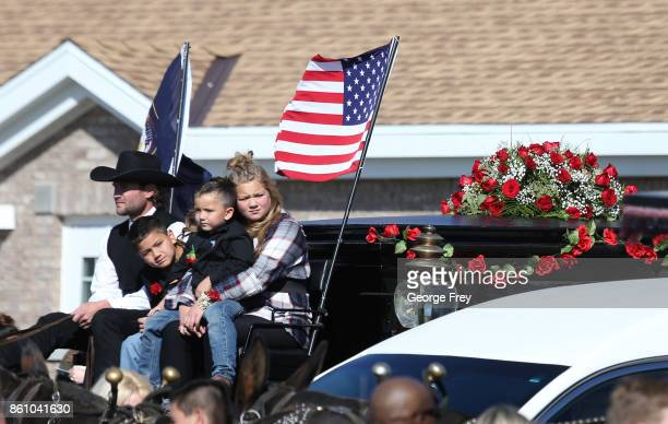 The kids of Heather Lorraine Alvarado sit on a horse drawn hurst carrying the casket of their mother after her funeral services on October 13 2017 in...