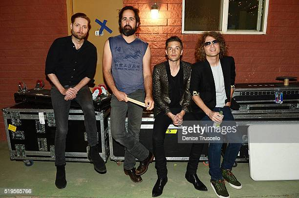 The Killers bass guitarist Mark Stoermer drummer Ronnie Vannucci Jr singer Brandon Flowers and guitarist Dave Keuning pose at Bunkhouse on April 7...