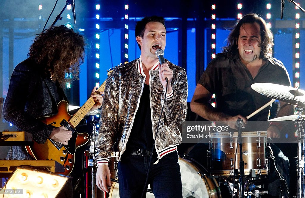 The Killers guitarist Dave Keuning singer Brandon Flowers and drummer Ronnie Vannucci perform at the 13th annual Andre Agassi Charitable Foundation's...