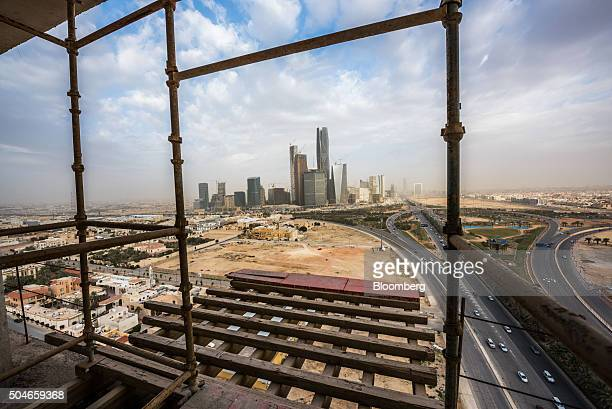 The King Abdullah financial district sits on the horizon seen from a skyscraper under construction in Riyadh Saudi Arabia on Sunday Jan 10 2016 Saudi...
