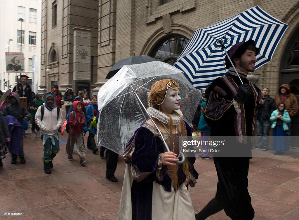 The King and Queen of England, Vicky Serdyuk, left, and Michael Berger, use their umbrellas to try and keep dry as they lead the parade. Despite rain and snow, over 5,000 Denver Public School students participate in the 32nd annual Denver Public School Shakespeare Festival at the Denver Center for the Performing Arts Complex.The day-long festival hosts a forum for students from Kindergarten through 12th grade to perform sonnets and scenes from the works of Shakespeare, as well as dance, vocal, and instrumental music of Shakespeare's time.