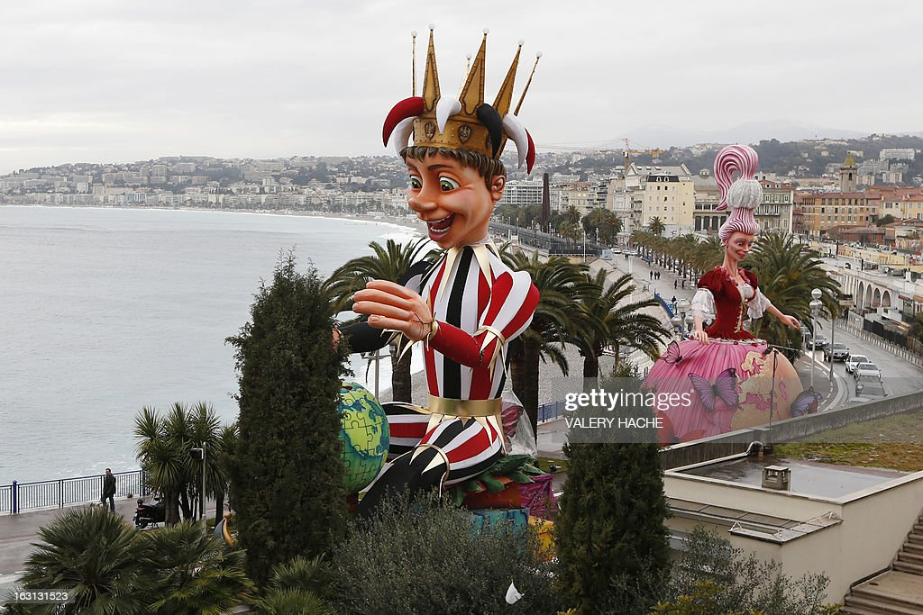 The King and the Queen figures move to hangar on March 5, 2013 in Nice, southeastern France, due to bad weather conditions annonced on the French Rivieria tonight. The Carnival, which ends on March 6, 2013, celebrates the 'King of the five continents', marking the 140th anniversary of the French Riviera Nice carnival.