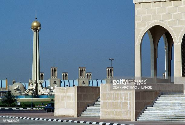 The King Faisal Mosque the Union Monument and the Souq Al Markazi or Blue Souq in the background Sharjah United Arab Emirates