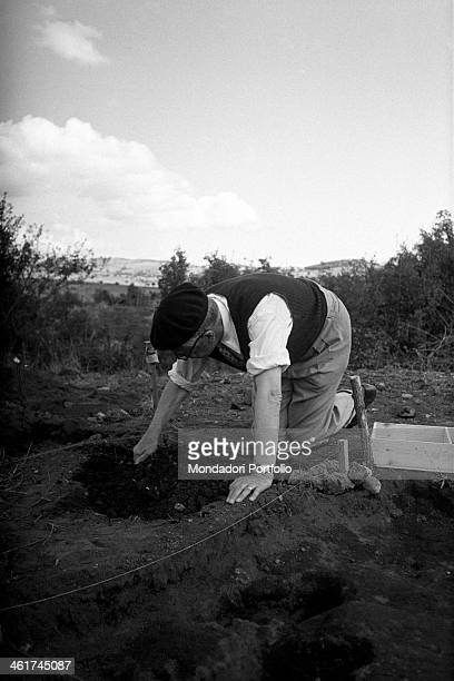 The king Gustaf VI Adolf of Sweden attending to some archaelogical excavations while he spends his summer holidays in the small village called...