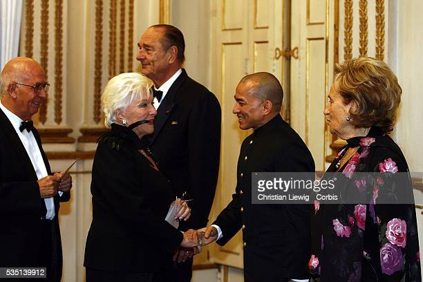 The King of Cambodia Norodom Sihamoni accompanied by French President Jacques Chirac and his wife Bernadette greets French singer Line Renaud at a...