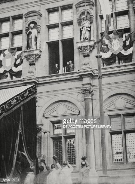 The King of Italy Vittorio Emanuele III on a visit to Paris greeting the crowd from a window of the Hotel de Ville together with French President...