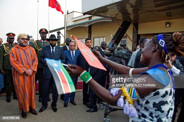 The King of Morocco Mohammed VI and the President of South Sudan Salva Kiir observe traditional dances on February 1 at Juba airport at the start of...