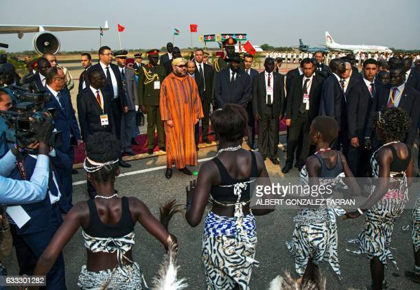 The King of Morocco Mohammed VI attends traditionnal dances next to president of South Sudan Salva Kiir during a welcoming ceremony on February 1 at...