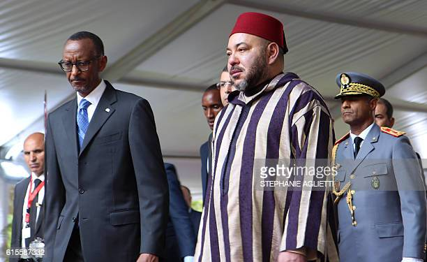 The King of Morocco Mohammed VI is welcomed by Rwandan President Paul Kagame on October 19 2016 in Kigali during his first stage tour of East Africa...